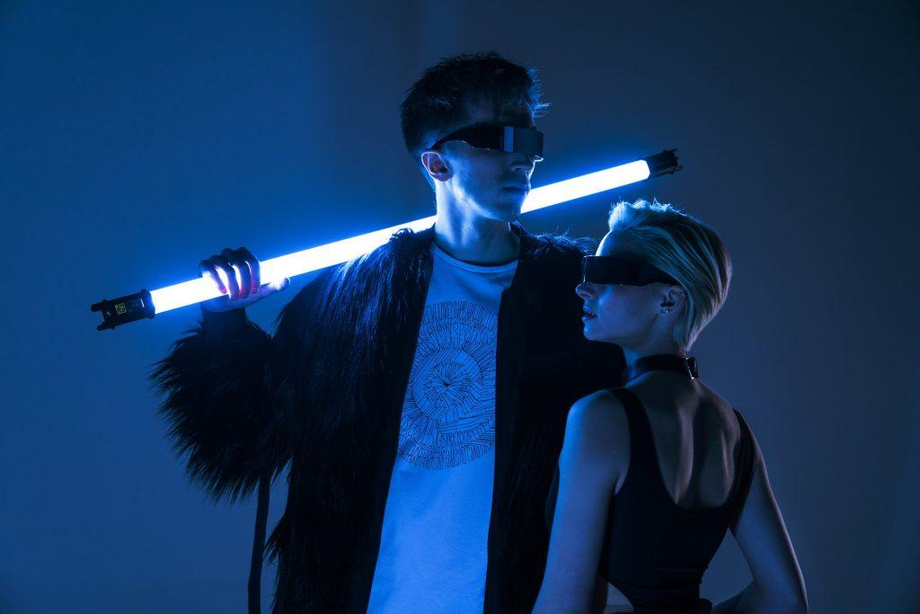woman in black tank top beside woman in blue sleeveless top