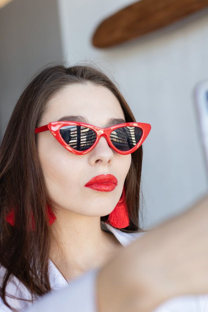 woman wearing classic red framed sunglasses