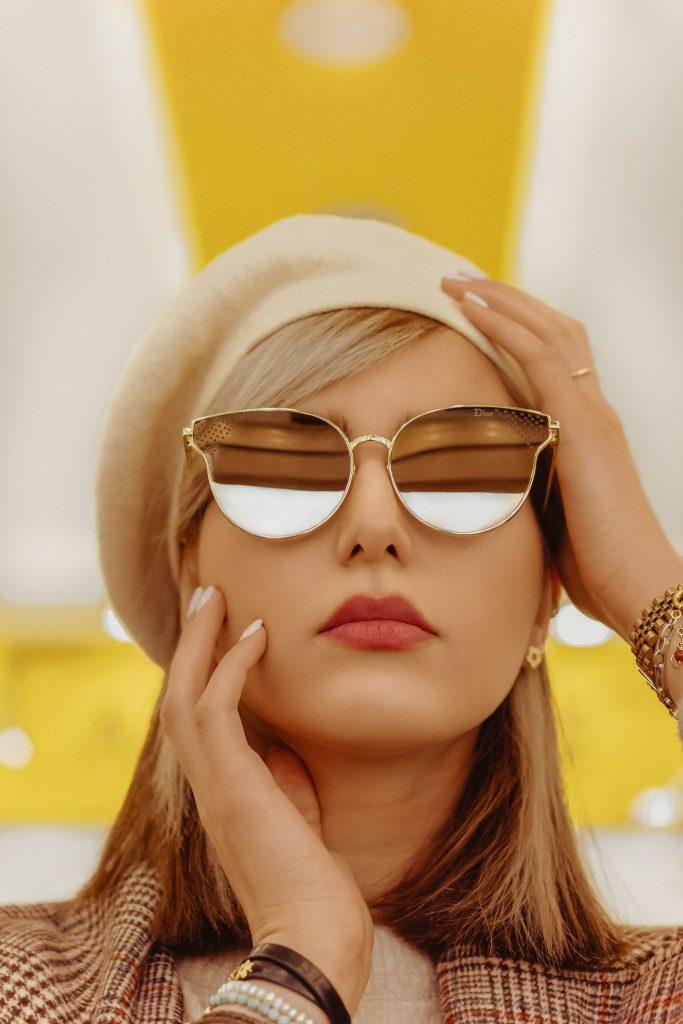 woman wearing gold framed aviator style sunglasses