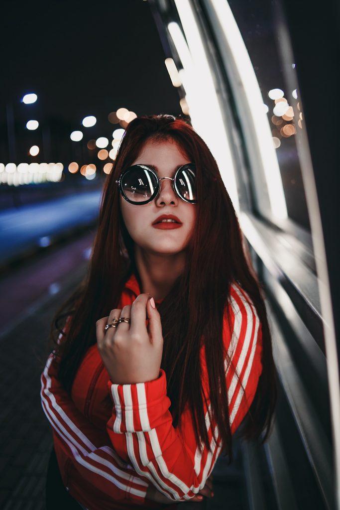woman wearing sunglasses bokeh photography